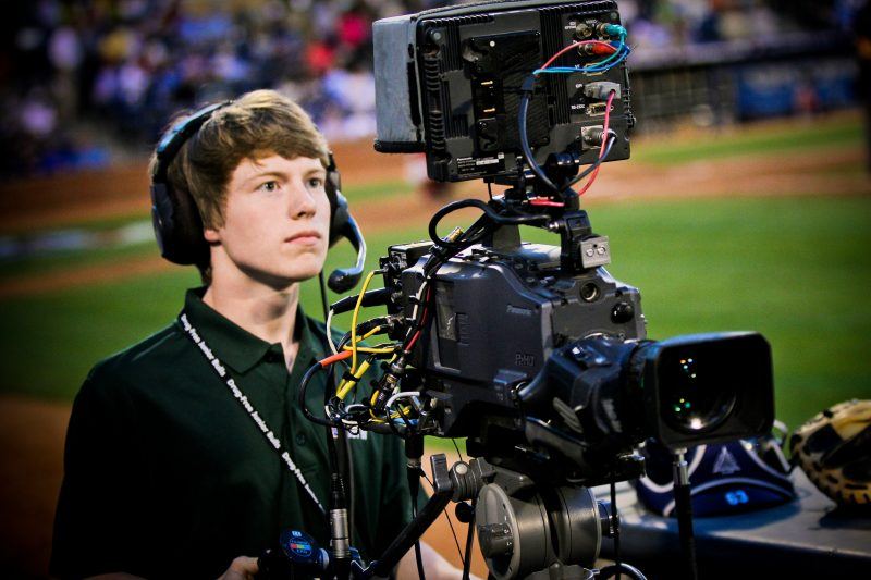 Post 50 student operating camera at Bulls game